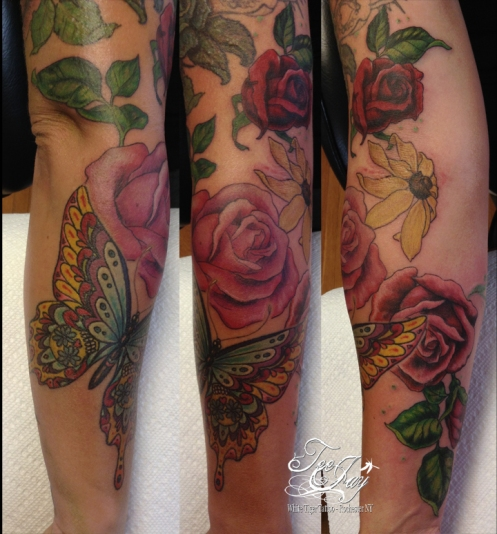 sugar skull butterfly tattoo with roses