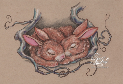 bunnies snuggled under roots