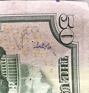 AC stamp on $50