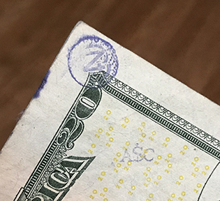ASc stamp on $20