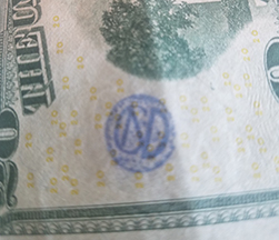 CND monogram circle mark on 20 bill