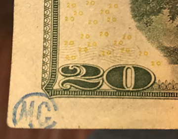 MC and circle stamp on $20