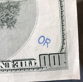 blue OR stamp on hundred dollar bill