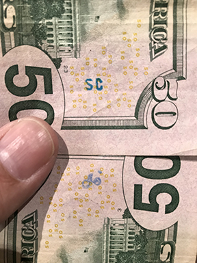 SC stamp on 50 dollar bill